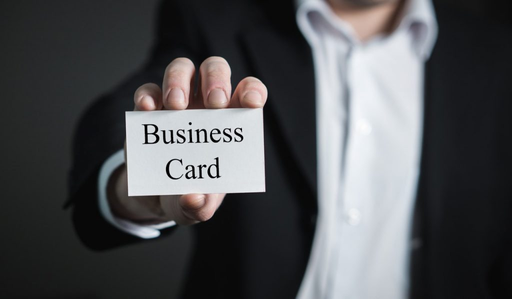Business man holding a business card