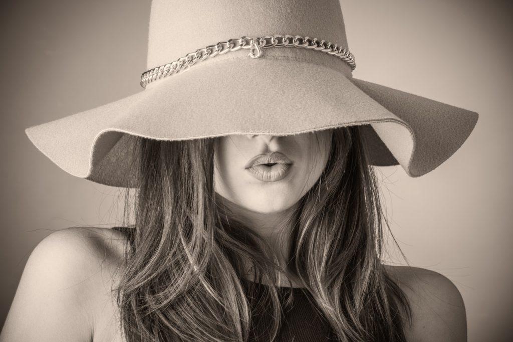 Beautiful woman wearing sunhat